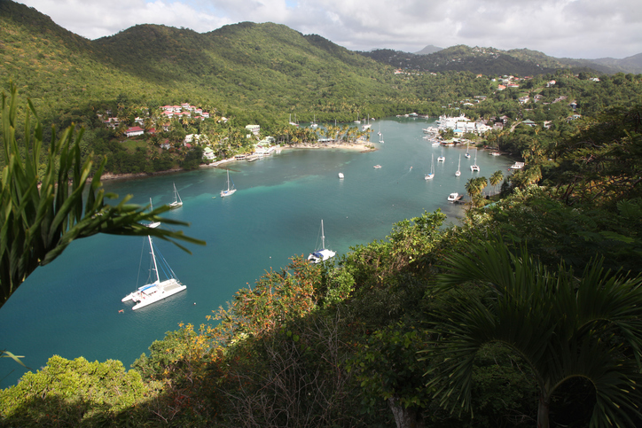 A high angle view of Marigot Bay, a historic landmark on the Caribbean island of St. Lucia. Now a haven for the yachting fraternity as can be seen by the number of yachts moored in the bay below