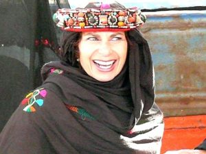 In the market of Agdz, dressed in Moroccan bridal headgear .