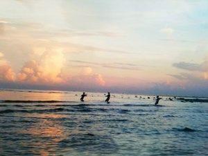 Fisherman at sunrise . The South China Sea Lovina.